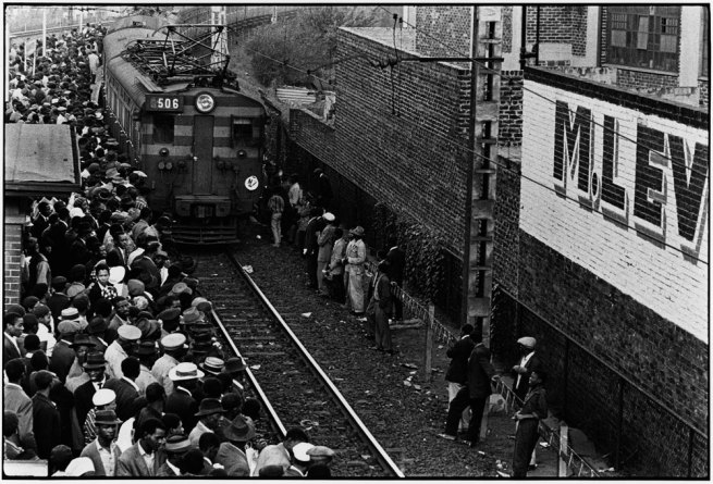 Ernest Cole. 'Africans throng Johannesburg station platform during late afternoon rush' 1960–1966