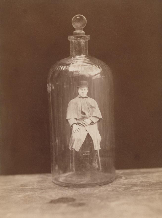 J.C. Higgins and Son. 'Man in bottle' c. 1888