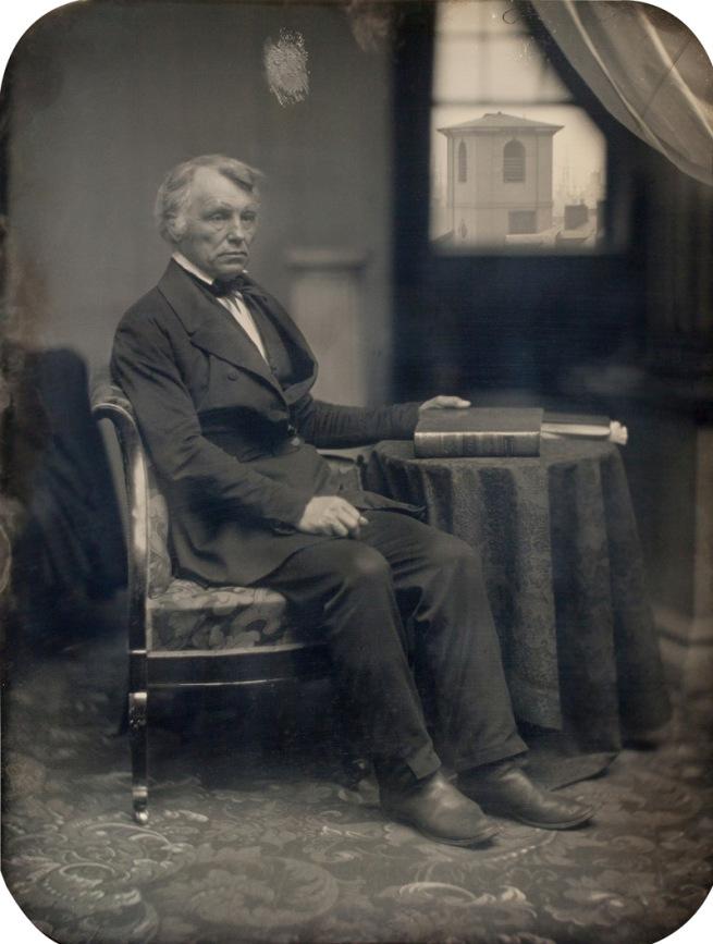 Albert Sands Southworth, Josiah Johnson Hawes. 'Seated man with Brattle Street Church seen through window' 1850s