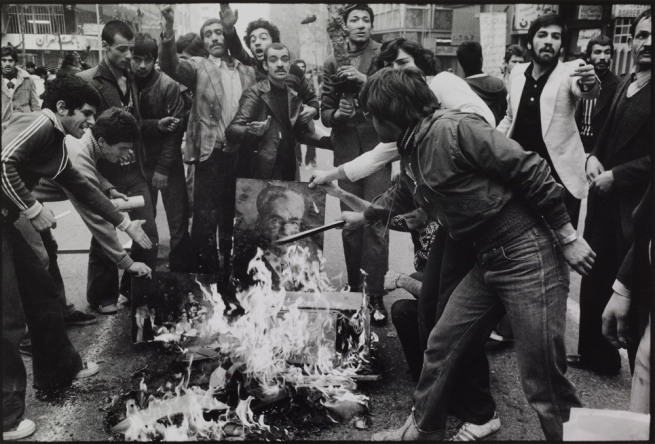 Abbas. 'France Rioters burn a portrait of the Shah as a sign of protest against his regime. Tehran, December 1978' 1978-9
