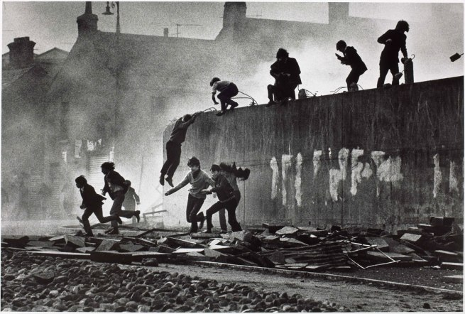 Don McCullin. 'Catholic youth escaping a CS gas assault in the Bogside, Londonderry, Northern Ireland' 1971