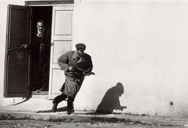 Don McCullin. 'Turkish defender leaving the side-entrance of a cinema, Limassol, Cyprus' 1964
