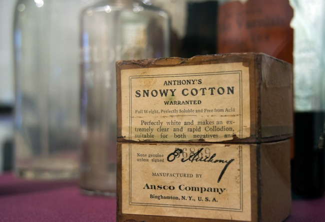 "A box of gun cotton (cotton treated with nitric acid) carrying the brand name ""Anthony's Snowy Cotton,"" a photo processing supply that a Civil War-era photographer might use in the field to create collodion photographs."