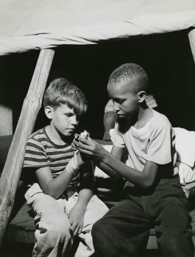 Gordon Parks. 'First Aid: Interracial activities at Camp Nathan Hale, Southfields, NY, 1943' 1943