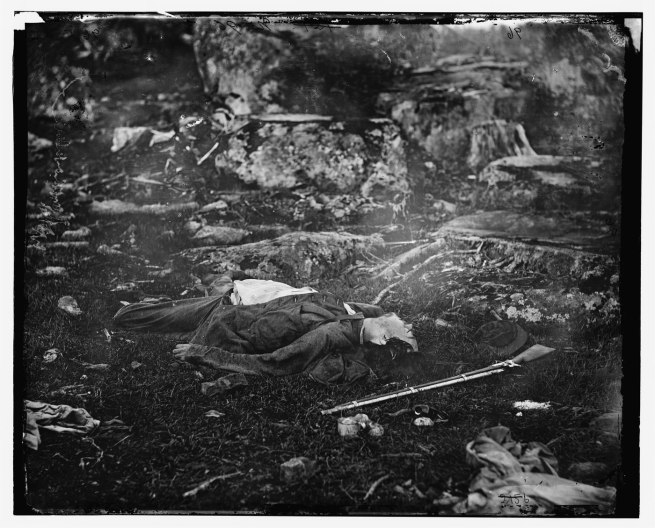 "Alexander Gardner (1821-1882) '[Gettysburg, Pennsylvania. Dead Confederate sharpshooter in ""The devil's den.""]' July 1863"