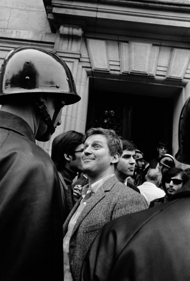 Gilles Caron. 'Daniel Cohn-Bendit facing a CRS in front of the Sorbonne, Paris, 6 May 1968' 1968