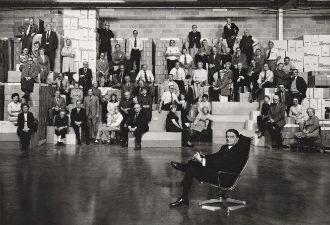 Arnold Newman. 'Dr. Edwin H. Land with group of Polaroid Employees, Polaroid warehouse in Needham, Mass.,' 1977