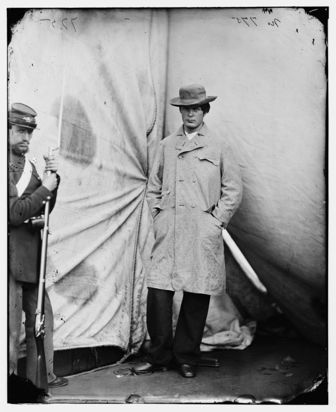 Alexander Gardner (1821-1882) '[Washington Navy Yard, D.C. Lewis Payne, the conspirator who attacked Secretary Seward, standing in overcoat and hat]' April 1865