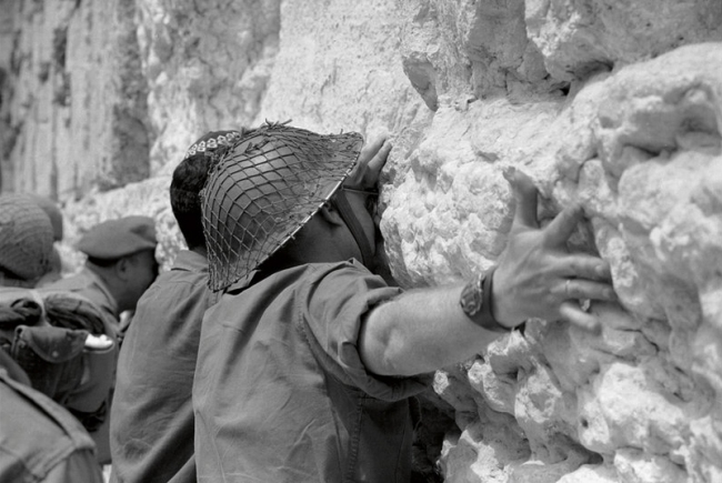 Gilles Caron. 'Israeli Soldiers at the Wailing Wall at the end of the Six Day War in 1967' 1967