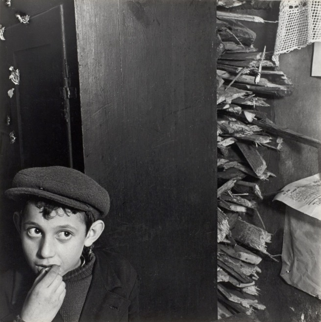 Roman Vishniac. 'Untitled [Boy with kindling in basement dwelling, Krochmalna Street, Warsaw]' c. 1935-38