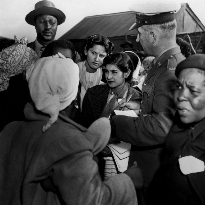 Jurgen Schadeberg. 'The 29 ANC Women's League women are being arrested by the police for demonstrating against the permit laws, which prohibited them from entering townships without a permit, 26th August 1952' 1952