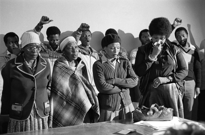 Gille de Vlieg. 'Pauline Moloise (mother of Ben), two women & Winnie Madikizela Mandela mourn at the Memorial Service for Benjamin Moloise, who was hanged earlier that morning. Khotso House, Johannesburg, October 18, 1985' 1985