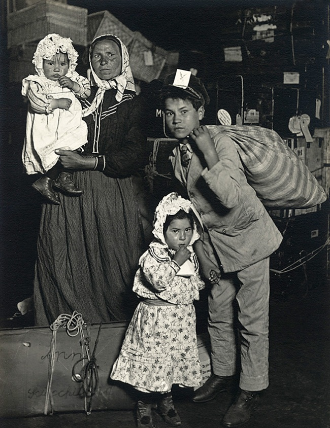 Lewis W. Hine (American, 1874–1940) 'Italian Family Looking for Lost Baggage, Ellis Island, New York' 1905