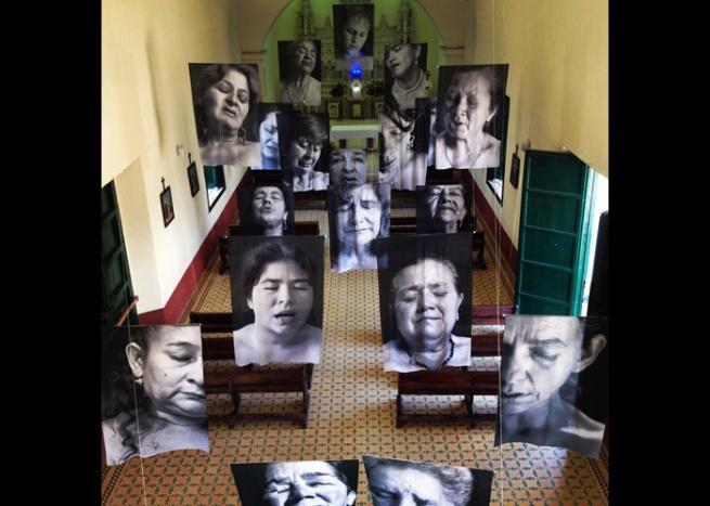 Installation photograph of Erika Diettes 'Sudarios' (Shrouds) at Iglesia de Chinquinquirá (La Chinca). Santa Fe de Antioquia [COL] December 5-9, 2012