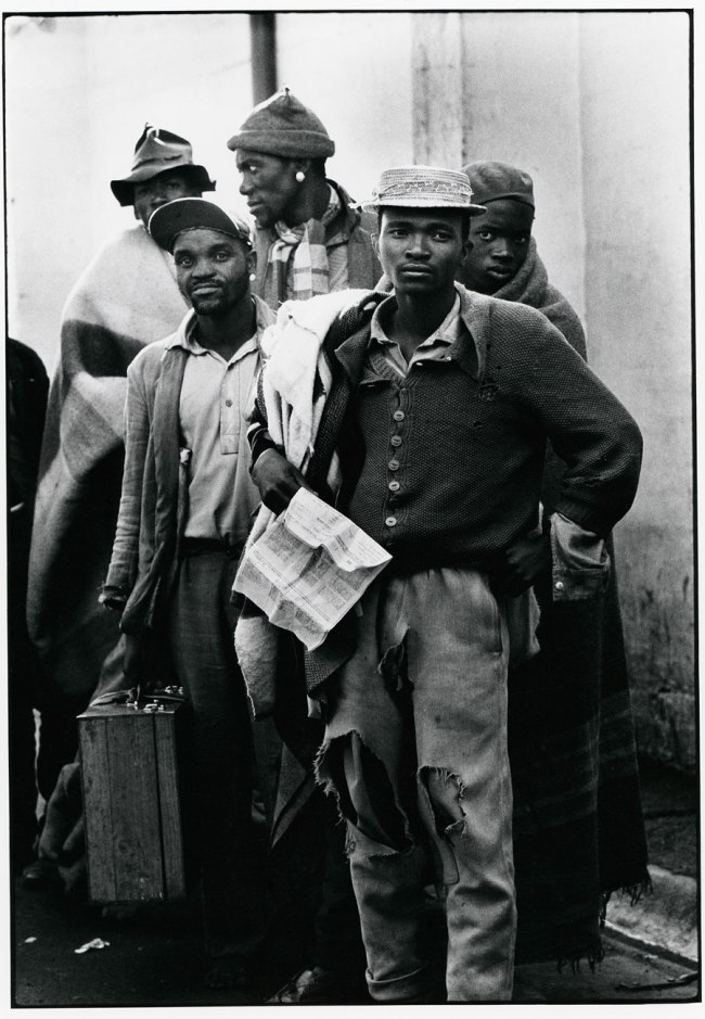 Ernest Cole (1940-1990) 'Pensive tribesmen, newly recruited to mine labour, awaiting processing and assignment' 1960-1966