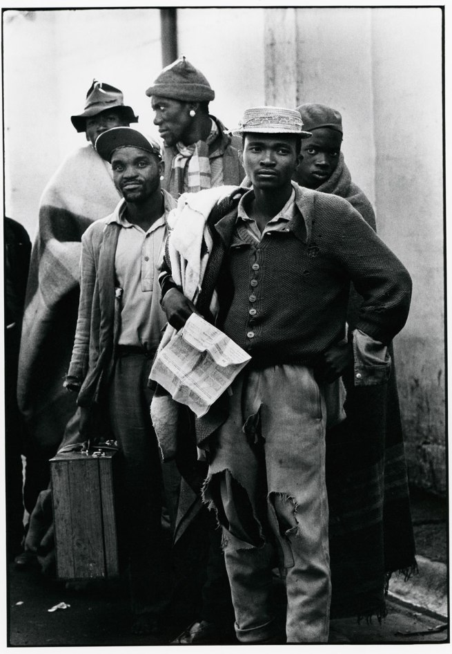 Ernest Cole (1940 - 1990) 'Pensive tribesmen, newly recruited to mine labour, awaiting processing and assignment' 1960-1966