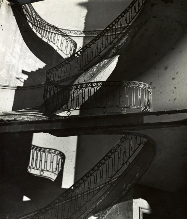 Bill Brandt (British, born Germany. 1904-1983) 'Bombed Regency Staircase, Upper Brook Street, Mayfair' c. 1942