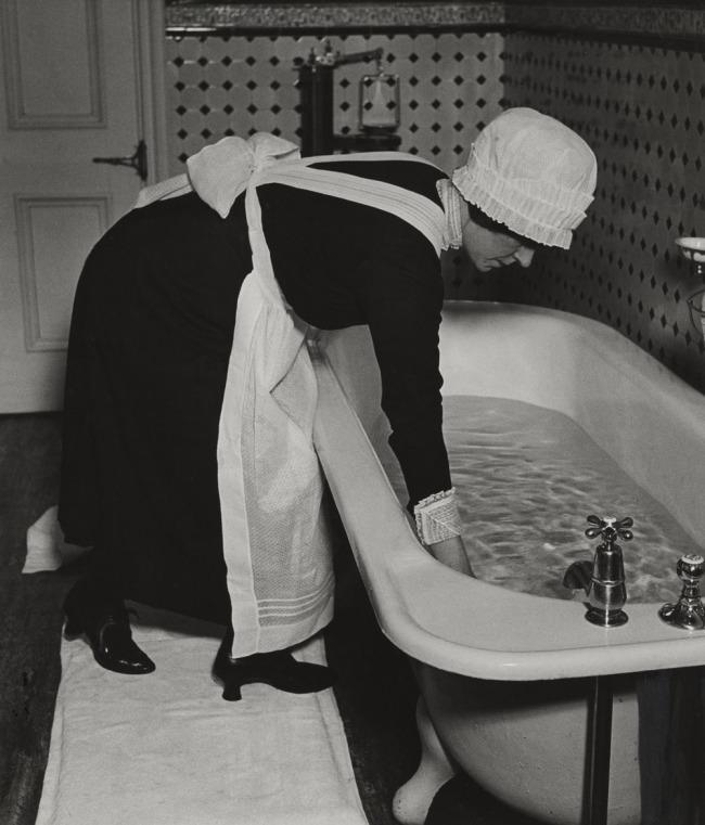 Bill Brandt (British, born Germany. 1904-1983) 'Parlourmaid Preparing a Bath before Dinner' c. 1936