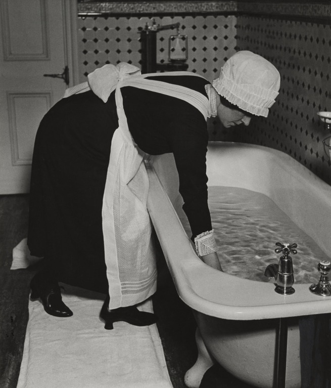 Bill Brandt (British, born Germany. 1904-1983) 'Parlourmaid Preparing a Bath before Dinner' c. 1936