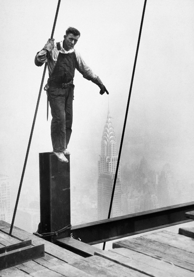 Lewis Hine. '[Steelworker touching the tip of the Chrysler Building]' c. 1931