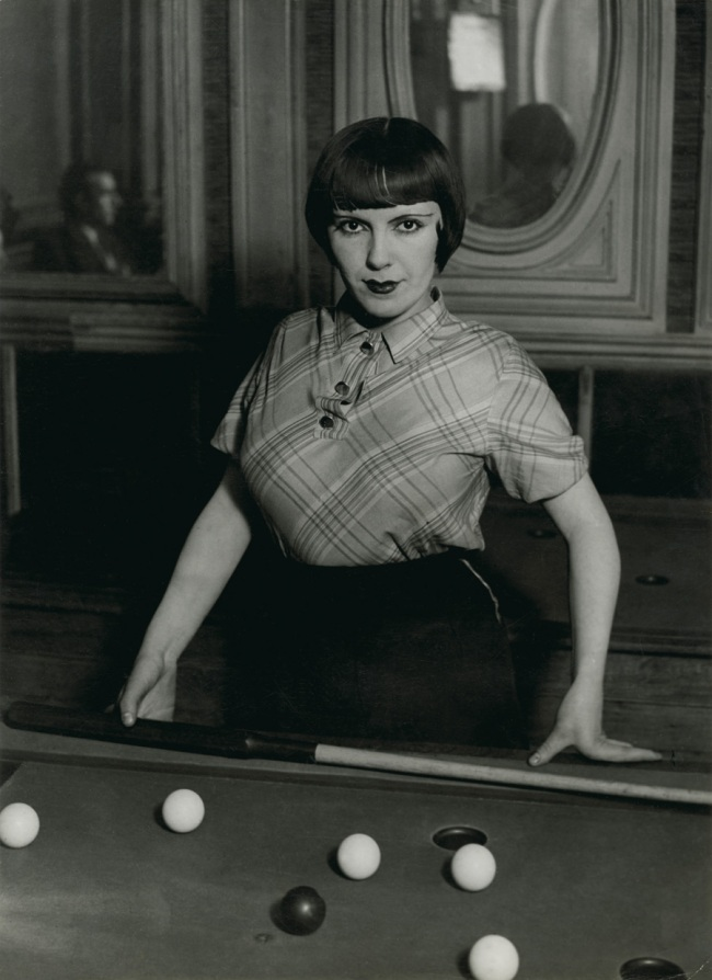 Brassaï (French, 1899-1984) 'Fille de Montmartre playing Russian billiards, Blvd Rochechouart' 1932-33