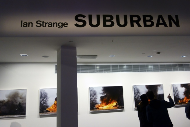 Installation photograph of Ian Strange film stills from 'SUBURBAN' © Marcus Bunyan