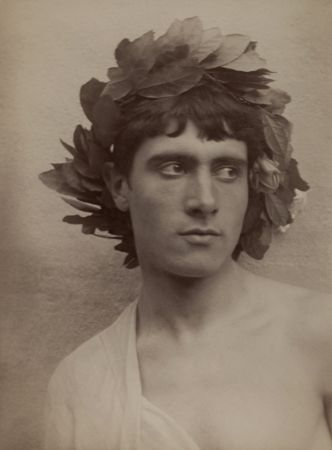 Baron Wilhelm von Gloeden (German, 1856-1931) 'Youth with wreath on head' c. 1900