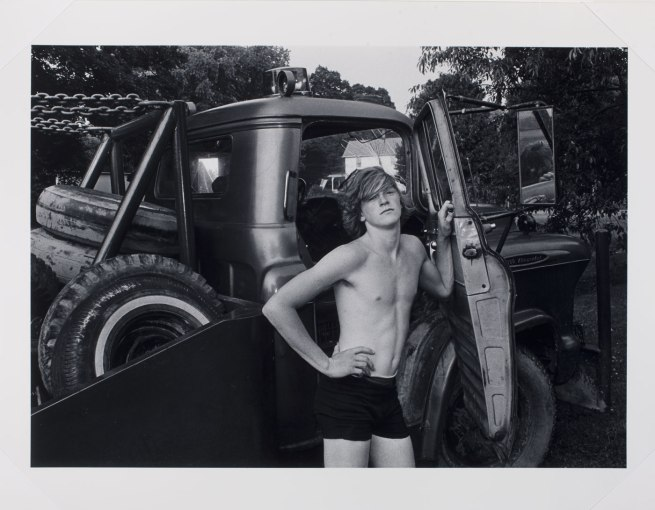 Mark Goodman (American b. 1946) 'Donald York, Jr. standing beside his father's wrecker, Millerton, New York' 1974