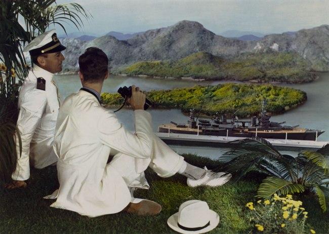 Lejaren à Hiller (American, 1880-1969) 'Men posed in front of backdrop with ship' c. 1950