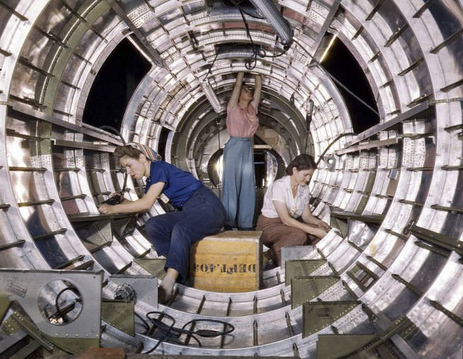 Alfred Palmer. 'Workers installing fixtures and assemblies in the tail section of a B-17F bomber at the Douglas Aircraft Company plant in Long Beach , California' October 1942