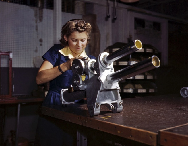 Alfred Palmer. 'Young woman employee of North American Aviation working over the landing gear mechanism of a P-51 fighter plane. Inglewood, California' October 1942