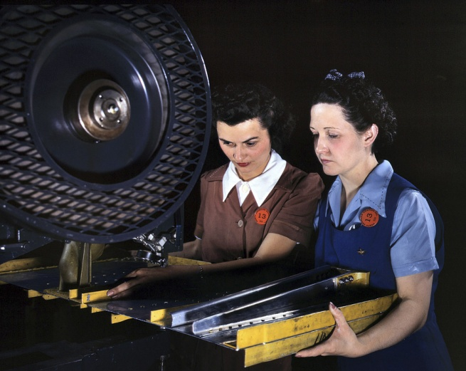 Alfred Palmer. 'Punching rivet holes in a frame member for a B-25 bomber at North American Aviation. Inglewood, California' June 1942
