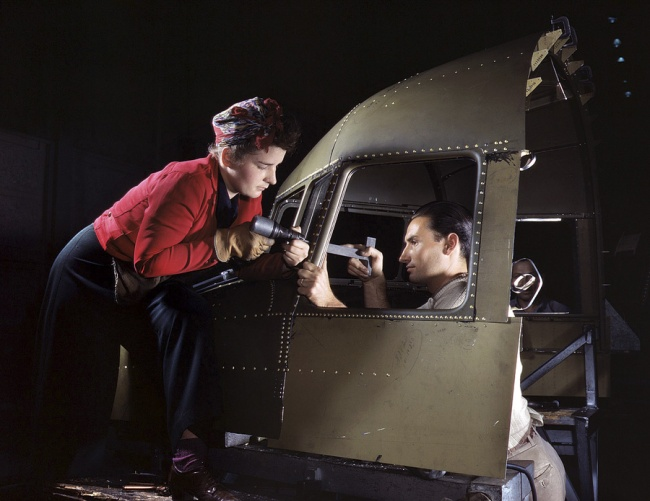 Alfred Palmer. 'Inglewood, California. Riveting team working on the cockpit shell of a C-47 heavy transport at North American Aviation' 1942