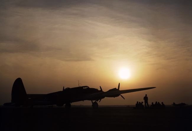 Alfred Palmer. 'Sunset silhouette of a flying fortress, at Langley Field, Virginia, in July, 1942' July 1942