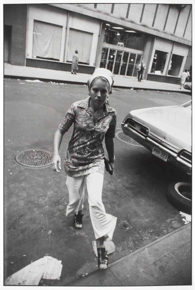 Garry Winogrand (American, 1928-1984) 'Untitled (Woman Crossing Street, New York)' about 1970