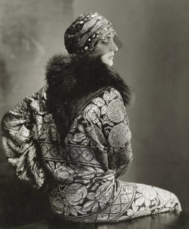 Edward Steichen (American 1879-1973, emigrated to United States 1881, worked in France 1906-23) 'Model wearing a black tulle headdress by Suzanne Talbot and a brocade coat with black fox collar' 1925