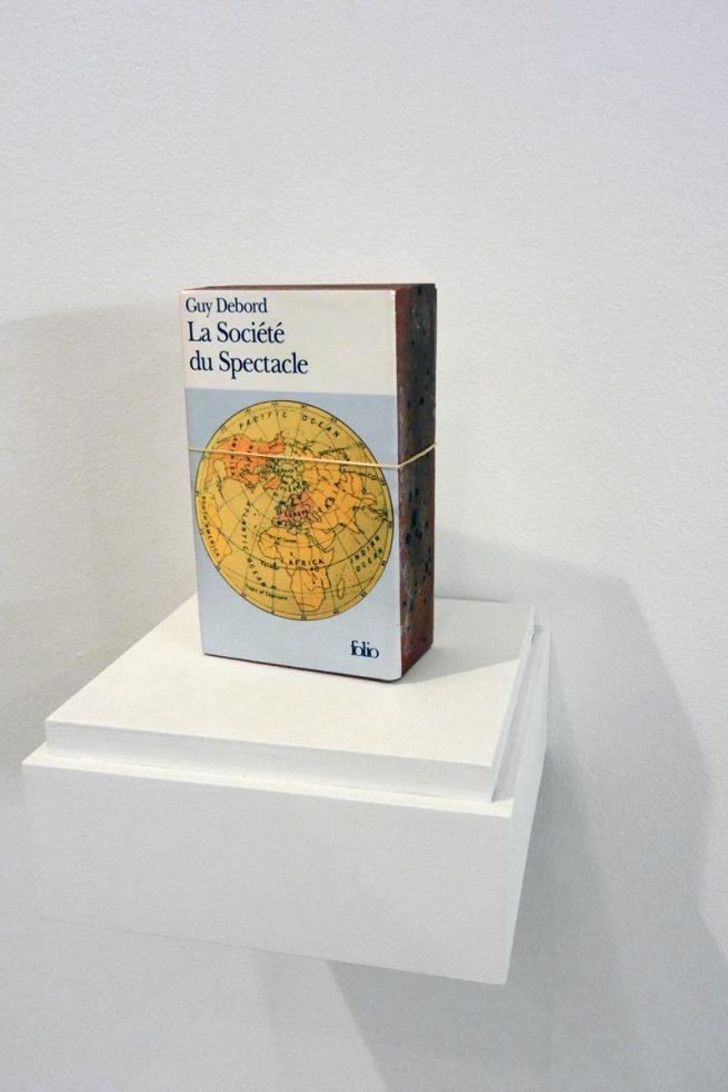 Claire Fontaine. 'La société du spectacle brickbat' 2006