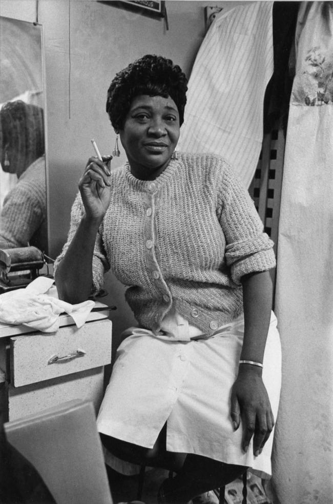 Enrico Natali. 'Hair stylist smoking, Detroit, 1968' 1968