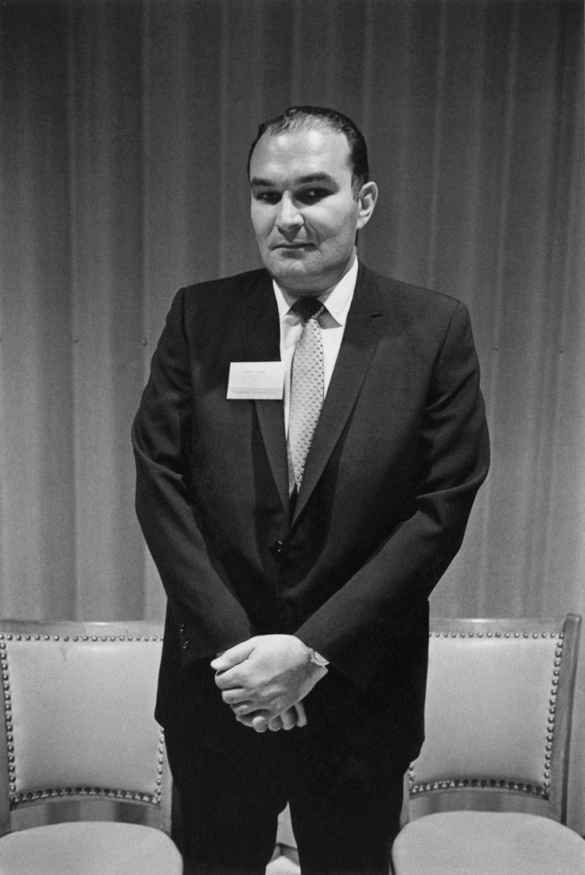 Enrico Natali. 'Businessman at a press party, Detroit, 1968' 1968
