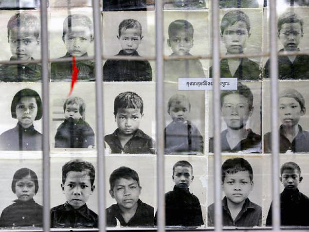 Photos of child victims on display at the Toul Sleng Genocide museum in Cambodia