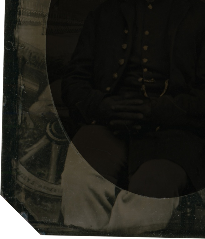 Unknown photographer. 'Private Abraham F. Brown' (inverted with overmat to show background extraneous to portrait - detail of writing on wheel) 1863