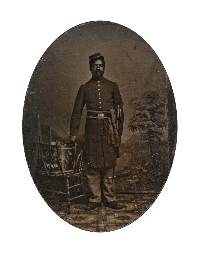 Unknown photographer. 'Private William J. Netson, musician' (with overmat) c. 1863-1864