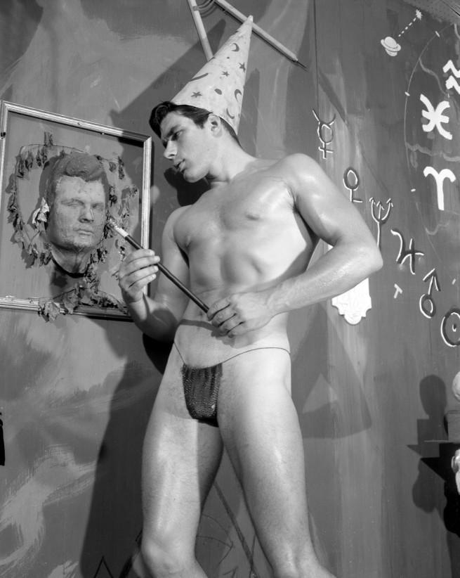 Bob Mizer. 'Untitled [Dennis Schreffer with Portrait], Los Angeles' c. 1957