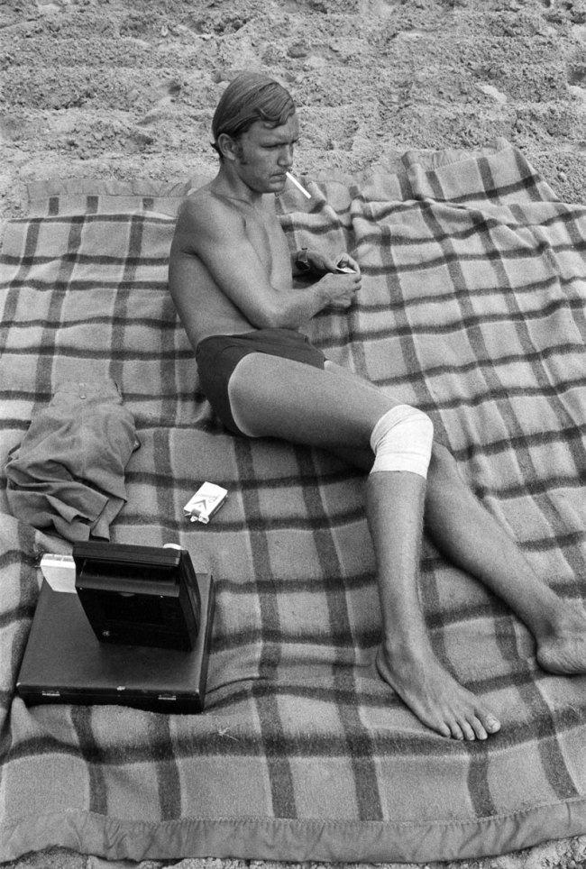 Enrico Natali. 'Man with injured knee at the beach smoking, Detroit, 1968' 1968