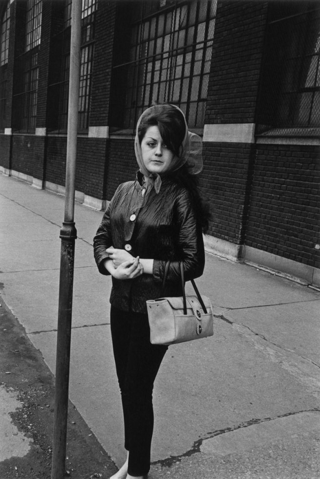 Enrico Natali. 'Woman outside a tire factory waiting for the bus, Detroit, 1968' 1968