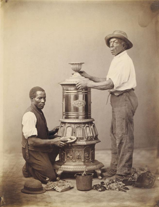 Unidentified artist. '[Two Workmen Polishing a Stove]' c. 1865