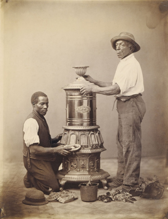Unidentified artist. '[Two Workmen Polishing a Stove]' c. 1865
