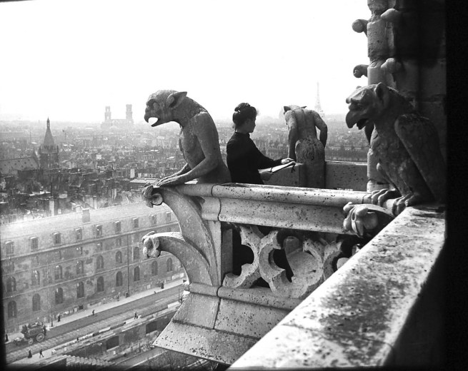 Félix Thiollier (1842-1914) 'Emma Thiollier painting on top of one of the towers of Notre Dame, photographed by her father Félix Thiollier' 1907