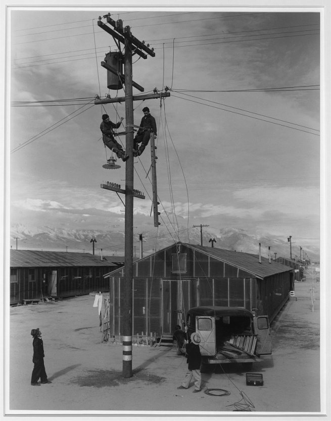 Ansel Adams (American, 1902-1984) 'Line crew at work in Manzanar, Manzanar Relocation Center' 1943