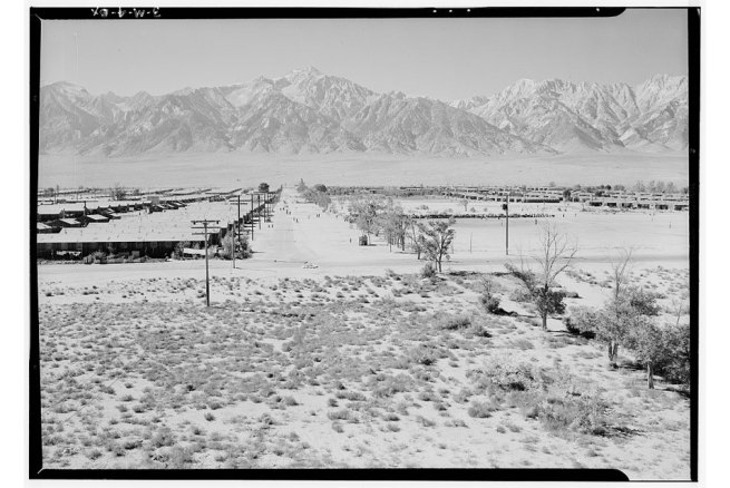 Ansel Adams (American, 1902-1984) 'Manzanar from Guard Tower, view west (Sierra Nevada in background), Manzanar Relocation Center' 1943